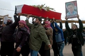 In this photo released by the Syrian official news agency SANA - In this photo released by the Syrian official news agency SANA, mourners carry the coffin of Rafat Nashat during a mass funerals in Sweida province, Syria, Saturday, Nov. 10, 2018.  Nashat was kidnapped by Islamic State militants with nearly two dozen others in July from the southern Sweida province during a bloody attack on their villages.  (SANA via AP) Syria - AP PROVIDES ACCESS TO THIS PUBLICLY DISTRIBUTED HANDOUT RELEASED BY SANA TO BE USED ONLY TO ILLUSTRATE NEWS REPORTING OR COMMENTARY ON THE FACTS OR EVENTS DEPICTED IN THIS IMAGE. MANDATORY CREDIT