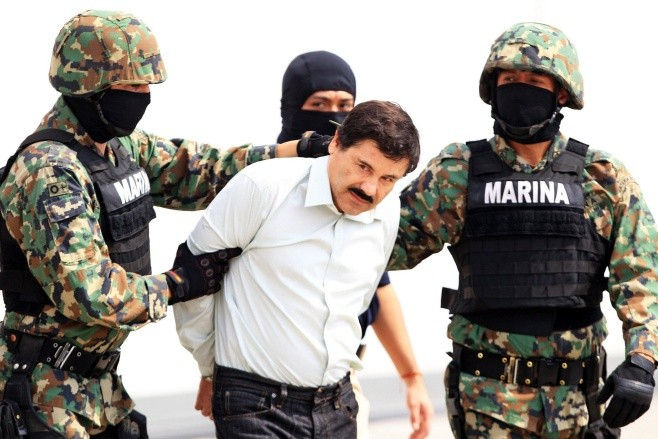 Drug lord Chapo Guzman captured - epa04096602 Mexican military hold Mexican drug lord Joaquin Guzman Loera, alias 'El Chapo' (C) at the Navy hangar in Mexico City, Mexico, 22 February 2014. The head of the Sinaloa drug cartel Joaquin 'El Chapo' Guzman was arrested on 22 February 2014 in Mazatlan in the Mexican state of Sinaloa. Reputed to be 'the most powerful drug trafficker in the world' by the United States, Guzman had been on the run for years.  EPA/MARIO GUZMAN