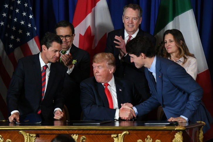 TOPSHOT - Mexican President Enrique Pena Nieto (L) - TOPSHOT - Mexican President Enrique Pena Nieto (L), US President Donald Trump (C) and Canadian Prime Minister Justin Trudeau are pictured after signing a new free trade agreement in Buenos Aires, on November 30, 2018, on the sidelines of the G20 Leaders' Summit. - The revamped accord, called the US-Mexico-Canada Agreement (USMCA), looks a lot like the one it replaces. But enough has been tweaked for Trump to declare victory on behalf of the US workers he claims were cheated by NAFTA. (Photo by Martin BERNETTI / AFP) TOPSHOT-ARGENTINA-G20-SUMMIT-US-CANADA-MEXICO-USMCA